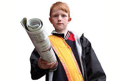 Newsboy delivering paper