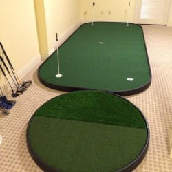indoor golf putting green with chipping pad