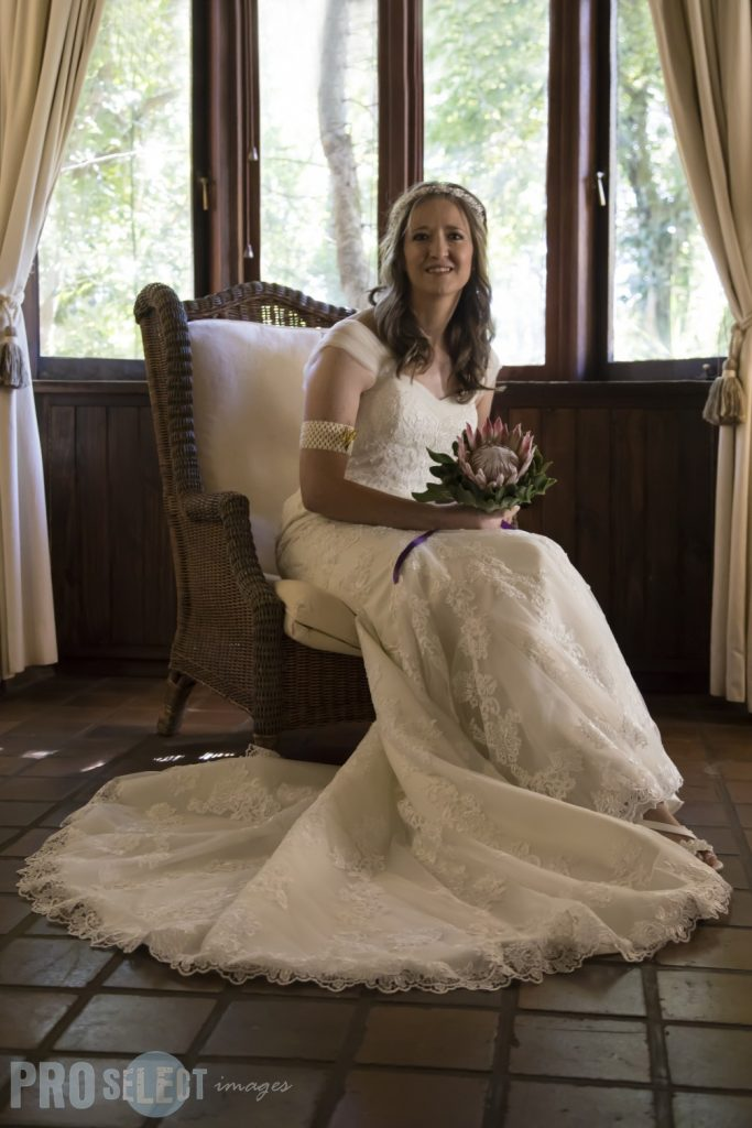 Bride sitting on a chair infront of the window