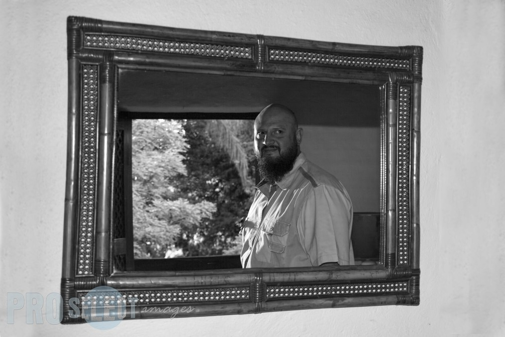 Refelction of groom in a mirror