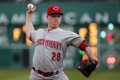 Cincinnati Reds starting pitcher Anthony DeSclafani (28) warms up before the second inning of a baseball game against the Pittsburgh Pirates in Pittsburgh, Thursday, May 7, 2015. (AP Photo/Gene J. Puskar)