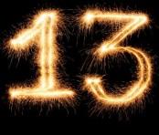Number 13 outlined in festive sparkler lights