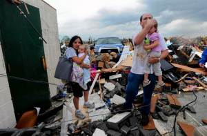 The Harrison Family leave their safe room following the 4/27/11 Alabama tornadoes.