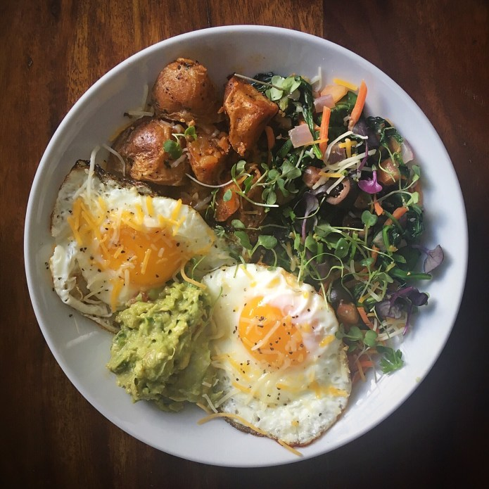 Two Eggs, Potatoes, Sautéed Spinach, and Guacamole
