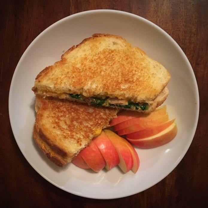 Grilled Cheese, Chicken, Spinach, and Tomato Sandwich, with an Apple