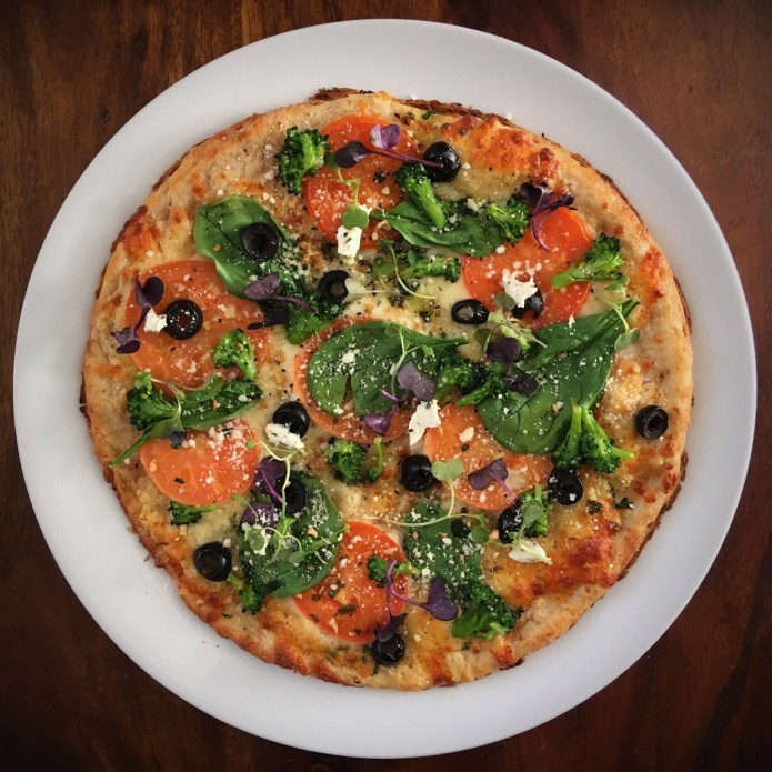 Pizza with Spinach, Tomatoes, Cheese, Broccoli, Microgreens, and Olives