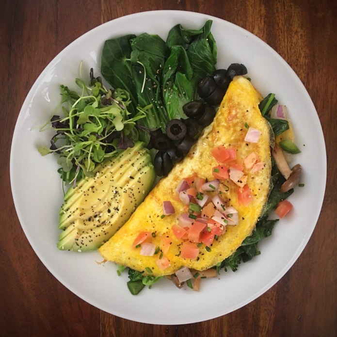 Omelette with Mushrooms, Broccoli, Spinach, and Pico de Gallo, Plus Olives, Bok Choy, Microgreens, and Avocado