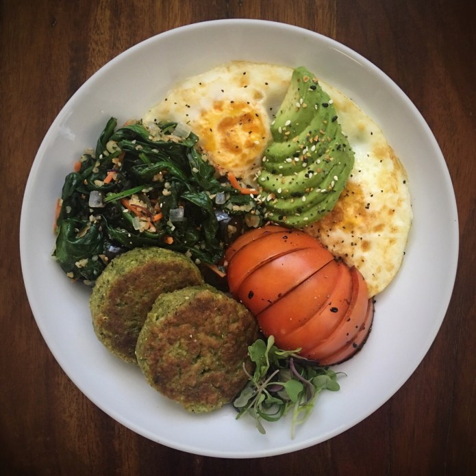 Breakfast Platter of Eggs, Avocado, Tomato, Balsamic Reduction, Spinach Salad (with Carrots, Onions, and Tabouleh), and Spinach/Kale Puck Things from Whole Foods (plus Microgreens!)