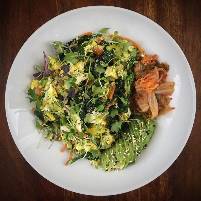Breakfast Scramble Roundup: Eggs, Spinach, Tomato, Carrots, and Microgreens, Scrambled, with a Side of Kimchi, and Avocado