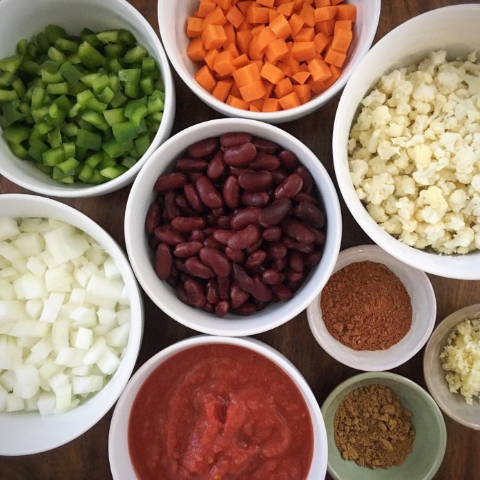 What Melissa Make 6 Mise En Place: Kidney Beans, Cauliflower, Carrots, Green Bell Peppers, Onion, Tomato, Garlic, and Spices