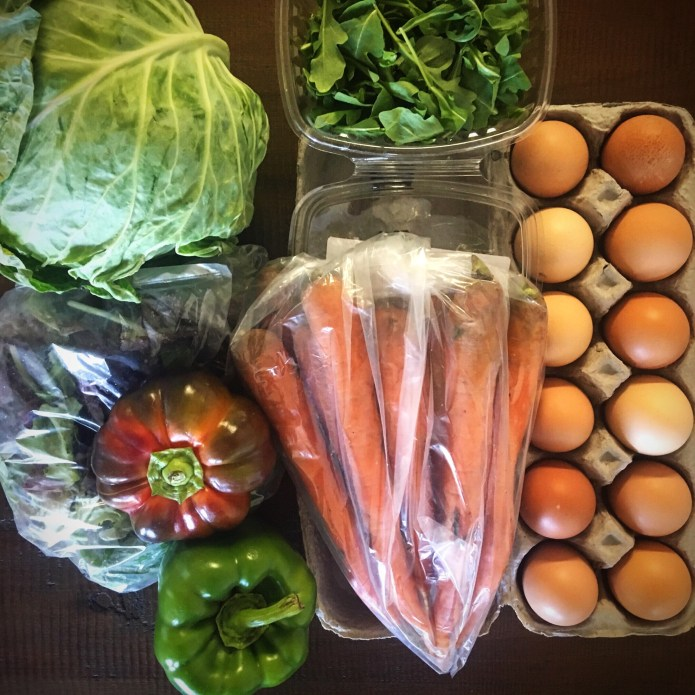 Cluck It Farms CSA Box Number 1: Cabbage, Mixed Greens, Heirloom Tomato, Green Bell Pepper, Arugula, Carrots, and Eggs