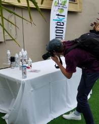 Beatbash photographer taking photos of the VIP Protekt Probiotics table