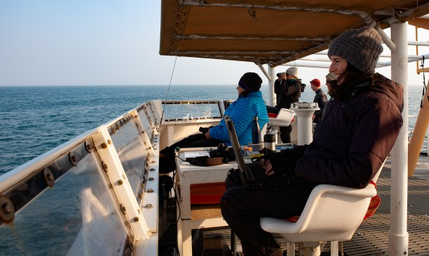 Wildlife observers Taylor Nairn(right) and Dru Devlin (left). Image Credit: Julie Chase/ACCESS/NOAA/Point Blue