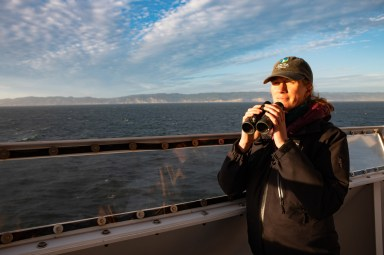 Kirsten Lindquist is the ecosystem monitoring manager for the Greater Farallones Association (GFA); she is also the birder for this ACCESS cruise. She's awestruck by ocean creatures that live in such extreme environments. Image Credit: Julie Chase/ACCESS/NOAA/Point Blue