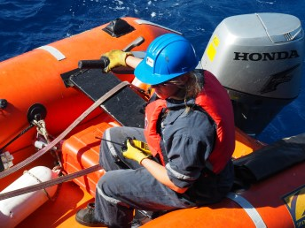 First Officer Martyna Graban helps survey the ship's hull. Image Credit: Jenny Woodman