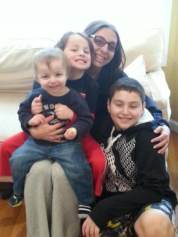 Pictured above is Barbi with her three sons, Leo (2.5 years old), Sol (5 years old), and Max (12 years old)
