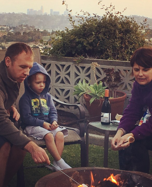 """Pictured above is Indre, her husband, and their 4 year old son. They decided to set-up an impromptu campsite in their backyard. They roasted marshmallows together while enjoying their backyard view of downtown LA (and a glass of wine!). Indre said """"It's simple moments like this that make me feel so blessed!"""""""