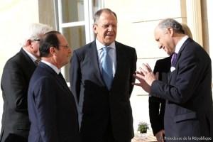 Sergei Lavrov  en Paris con Laurent Fabius y François Hollande