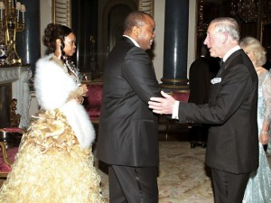 Britain's Prince Charles greets Swaziland's King Mswati III and his wife Inkhosikati LaMbikiza as they arrive for a dinner at Buckingham Palace in London