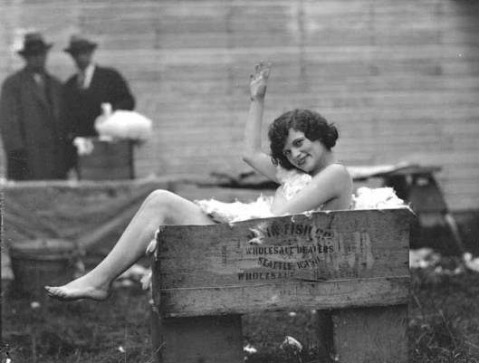 summer vintage bygone days past women in box full of feathers