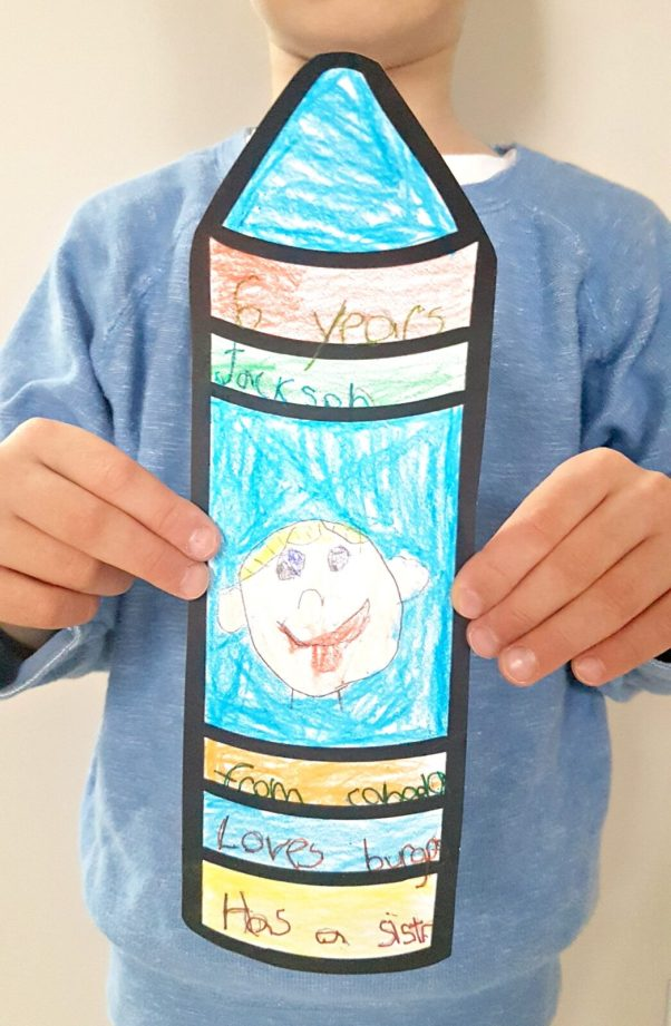 teaching respect - child holding a crayon cut out from paper with self-portrait