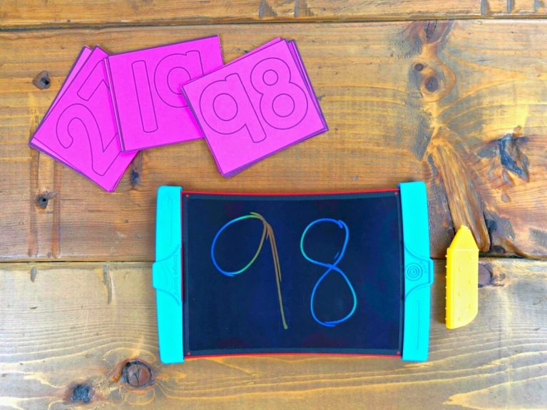 writing numbers on a board to 100