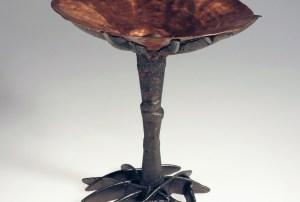 Iron Cast Through and Around Raised Copper Form