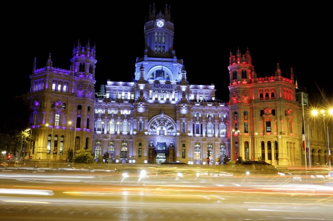 Madrid's Town Hall is illuminated with the colours of French flag in tribute of victims following a series of deadly attacks in Paris in Madrid