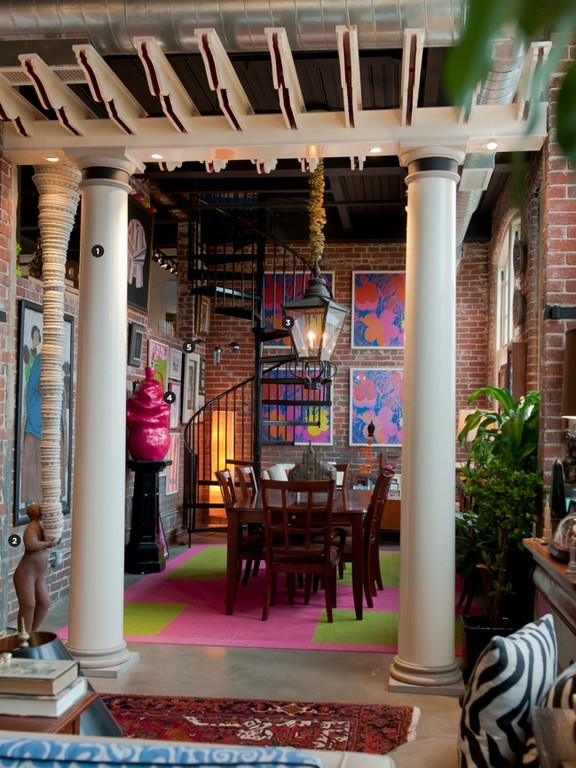 """Tripp: 1. I built this indoor pergola not long after we bought the loft in 2005. The columns came from a 19th-century house in Richmond, Virginia. They crossed the Mason-Dixon Line in a snowstorm, flagged and projecting four feet from the back of our station wagon. 2. This standing sculpture, an earthenware figure holding 109 graduated porcelain bowls, is Balancing Burden by the Chinese-American artist Eric Kao. Kao's work explores his identity as the son of immigrants - a theme that particularly resonated with Ed, who emigrated from the Azores with his parents in 1966. 3. This is a former gas streetlamp from Savannah, Georgia. It was rescued by my ex-sister-in-law, a Savannah native who will probably want it back if she ever sees this. 4. Providence artist Kik Williams made Bubble Gum Pink for a Steel Yard show (the hot pink """"glaze"""" is actually metallic auto-body paint). 5. Beyond Williams' sculpture are works by other Providence artists: Gregory Poulin, Jungil Hong, Dan Wood, Andrew Raftery and C. W. Roelle. We're lucky to have landed in a city that supports so many talented artists, and that's preserved so much of its industrial architecture - without one, you'd never have had the other."""