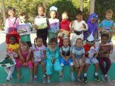 A happy class of Kindergarteners with their new book swap books.
