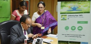 "The Union Minister for Science & Technology, Harsh Vardhan launching a mobile app on ""Celebrating Yoga"", at a function, in New Delhi on June 19, 2017."