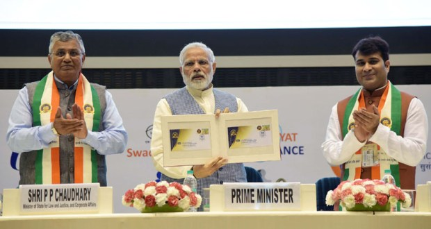 The Prime Minister, Narendra Modi releasing the ICSI Golden Jubilee Postal Stamp, at the Golden Jubilee Year Celebrations of the Institute of Company Secretaries of India (ICSI), in New Delhi on October 04, 2017. The Minister of State for Law & Justice and Corporate Affairs, P.P. Chaudhary is also seen.