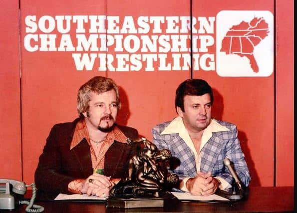 Les Thatcher and unidentified mc'ing Southeastern Championship Wrestling