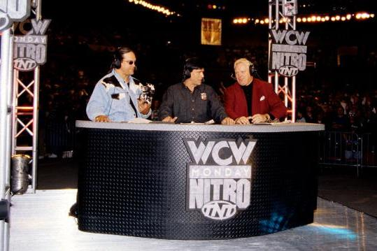 The announcers at the desk of WCW Monday Night Nitro