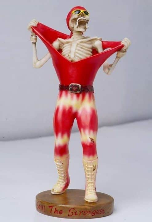 To show the effects of Steroid use in the WWE a photo of a Statue of skeleton dressed as Hulk Hogan ripping off his red and yellow tie dyed wrestling tights