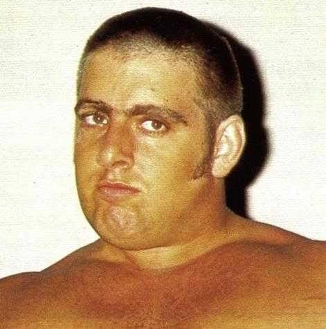 A young Ric Flair with dark brown hair in a crew cut