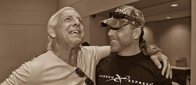 Ric Flair with his arm around Shawn Michaels shoulder sharing a laugh