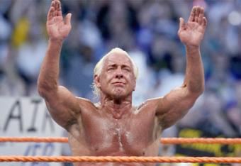 Ric Flair after his retirement match at WrestleMania 24 holding his hands up to say goodbye