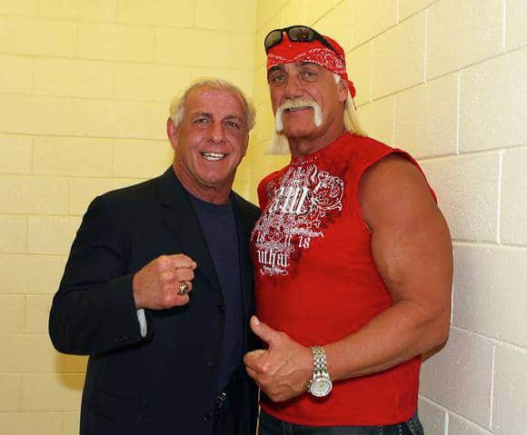 Ric Flair and Hulk Hogan strike a friendly pose