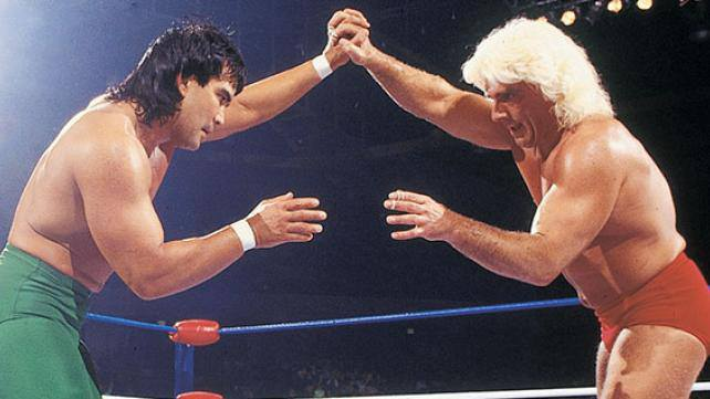 Steamboat and Flair during a match fixing to head off