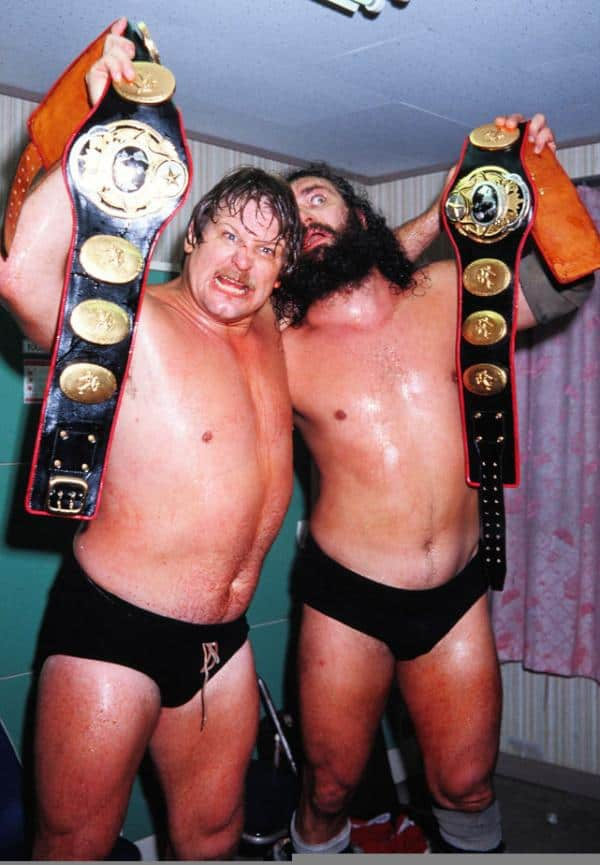 Stan Hansen and Bruiser Brody after a match holding up title belts