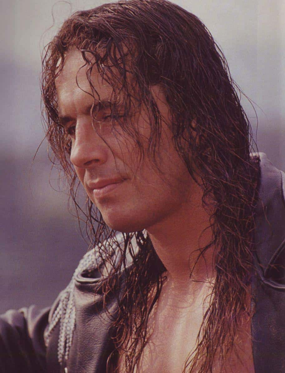 Bret Hart profile head shot with wet hair and a leather jacket on