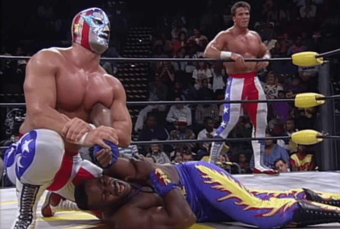 The Patriot as part of the team of 'Stars N Stripes' against Booker T and Harlem Heat, WCW
