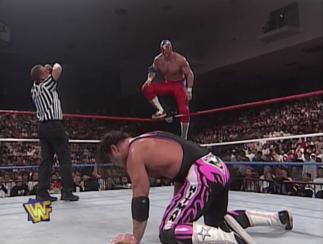The Patriot on the top rope in a battle with Bret Hart