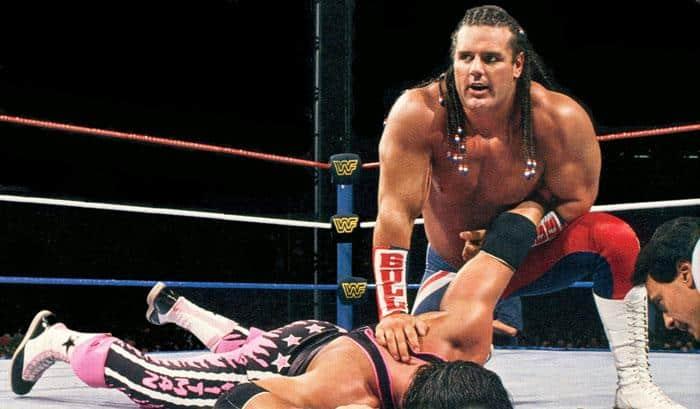British Bulldog has Bret Hart on the mat with his arm bent backwards at SummerSlam 1992