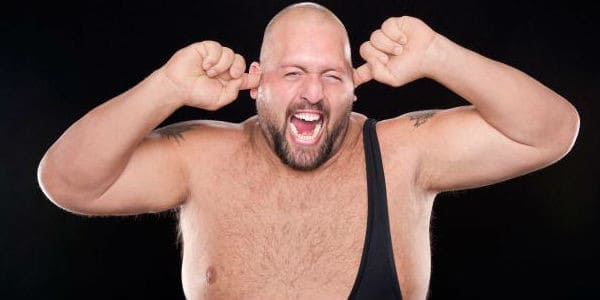 Big Show plugging his ears and laughing