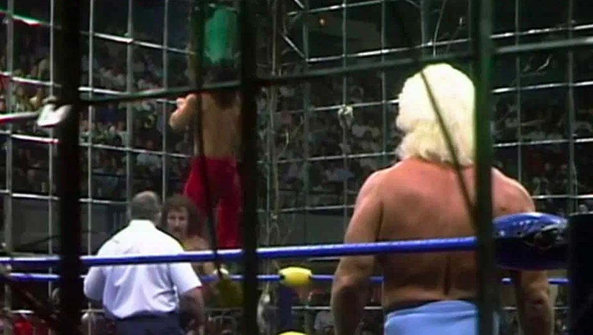 The Great Muta saves the day with his green mist at the inaugural Halloween Havoc in 1989. [photo courtesy of the WWE Network]
