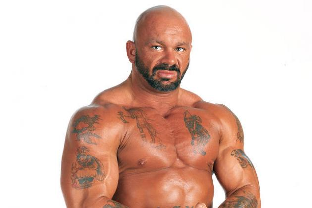 Perry Saturn posting with muscles and tats during his wrestling days