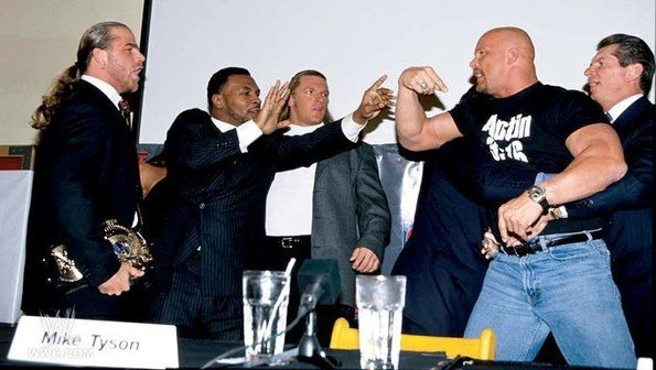 Steve Austin and Shawn Michaels getting worked up at a press conference with Mike Tyson and Vince McMahon trying to calm them down