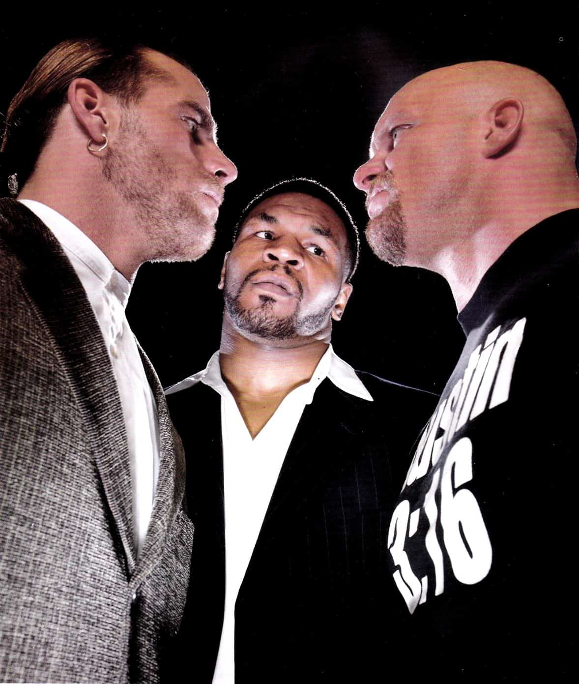 Promo shot for WrestleMania 14 of Steve Austin and Shawn Michaels facing each other with Mike Tyson in between them